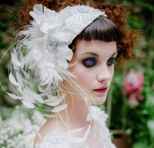 Beaded and feathered skullcap white bridal headpiece